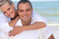 Couple by the sea Royalty Free Stock Photos
