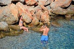 Couple in the sea, Agios Nikolaos. Royalty Free Stock Photos