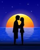 Couple on sea beach Stock Photography