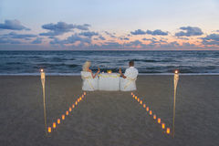 Couple at sea beach during luxury romantic dinner Royalty Free Stock Photos