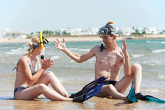 Couple at sea beach with snorkel set Royalty Free Stock Photography