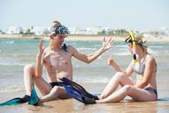 Couple at sea beach with snorkel set Stock Photos