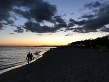 A couple in the sea beach sunset. Sea beach sunset a couple in evening sunset view royalty free stock images