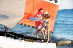 Couple on sea catamaran Stock Photo
