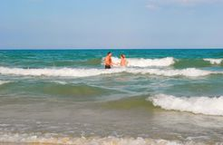 The couple in the sea. stock image