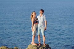 Couple by Sea at Sunset Royalty Free Stock Photo