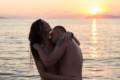 Couple sea water sunset Royalty Free Stock Photography