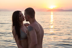 Couple sea water sunset stock images