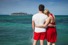 Couple at The Sean with Desert Island Royalty Free Stock Photography
