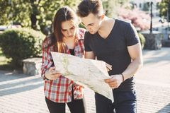 Couple searching location on map,planning vacation. Traveling, sightseeing, city tour, vacation, holiday. Couple searching the location on map, choosing place to Stock Images