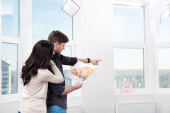 Couple in searching the real estate for a purchase stock image