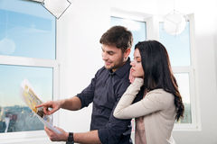 Couple in searching the real estate for a purchase Royalty Free Stock Image