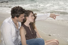 Couple on the seashore Stock Photos