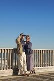Couple at Seaside Fishing Pier stock photos