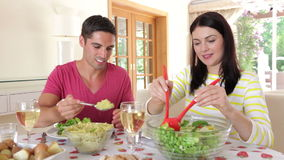 Couple seated around dining table  stock footage