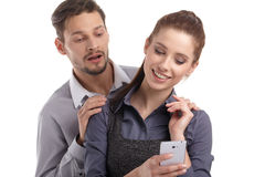 Couple and secret message on cell phone. Royalty Free Stock Photography