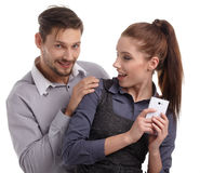 Couple and secret message on cell phone. Stock Images