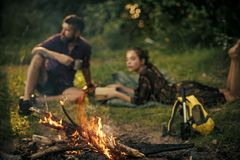 Couple secrets fantasy. Bonfire flame burn and blurred man woman relax on nature. Couple secrets fantasy. Bonfire flame burn and blurred men women relax on royalty free stock photography