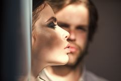 Couple secrets fantasy. Girl with makeup, eyeshadows, blush, foundation. Woman face profile with blurred men on background. Skin care, treatment, health Royalty Free Stock Image