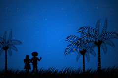 Couple see star down at night Stock Images