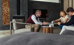 Couple seeing a psychotherapist to solve their problems Stock Image