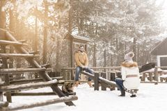 Couple on a seesaw Royalty Free Stock Photography