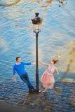Couple on the Seine embankment in Paris Stock Photo