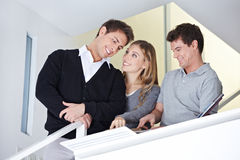 Couple selecting carpet from sample Stock Photos