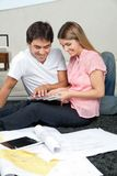 Couple Selecting Color From Swatches royalty free stock photo