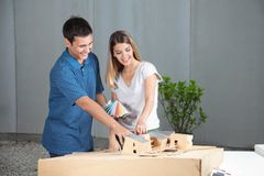 Couple Selecting Colors For Model House Royalty Free Stock Photo