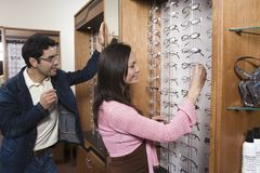 Couple Selecting Eye Glasses Stock Photo