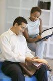 Couple Selecting Fabric Stock Image