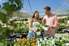 Couple Selecting Flower Plants Stock Image