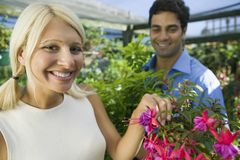 Couple selecting Flowers Royalty Free Stock Photos