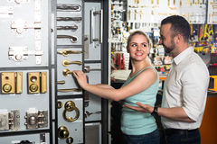 Couple selecting furniture handles in store Royalty Free Stock Photography