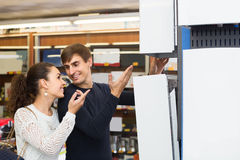 Couple selecting heating water converter in household store Royalty Free Stock Images