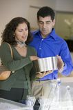 Couple selecting Kitchenware in store Stock Photo