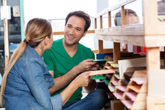 Couple Selecting Papers In Shop Royalty Free Stock Images