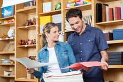 Couple Selecting Papers In Store Royalty Free Stock Photography