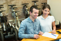 Couple selecting segways Stock Photos