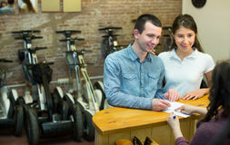 Couple selecting segways Stock Photography