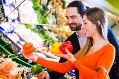 Couple selecting vegetables in hypermarket Stock Photo