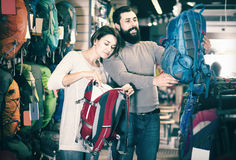Couple selects backpacks Royalty Free Stock Photo