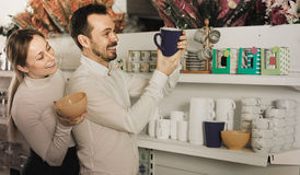 Couple selects bright mugs Stock Photography