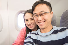 Couple selfie in airplane Stock Photo