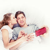 Couple Selfie in bed Stock Photography
