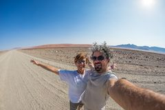 Couple selfie in the desert, Namib Naukluft National Park, Namibia road trip, travel destination in Africa. Couple selfie in the desert, Namib Naukluft National Stock Photography