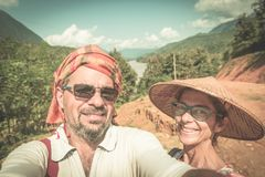 Couple selfie on mountain top at Nong Khiaw panoramic view over Nam Ou River valley Laos  travel destination in South East Asia, stock images