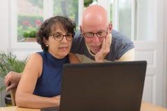 Couple of senior buy with internet Stock Photo