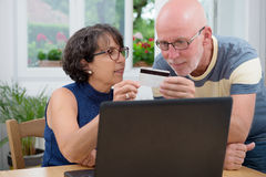 Couple of senior buy with internet Royalty Free Stock Photography